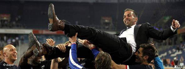 Hertha BSC coach Markus Babbel is held aloft by his team