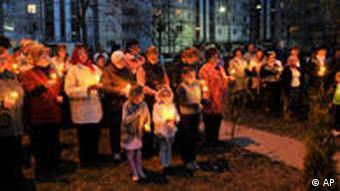 CORRECTS DATE - Ukrainians hold candles commemorating the 25th anniversary of the Chernobyl nuclear disaster in the capital city of Kiev,Tuesday, April 26, 2011. Ukraine marked the 25th anniversary since the Chernobyl power station exploded in the world's worst nuclear accident, endangering hundreds of thousands of lives and contaminating pristine forests and farmland. (AP Photo/Sergei Chuzavkov)