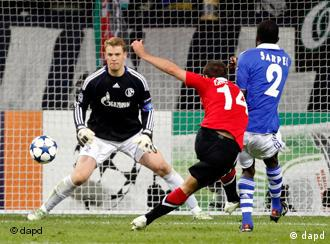 Manuel Neuer, left, Manhester United's Javier Hernandez, centre, taking a shot, and Schalke's Hans Sarpei