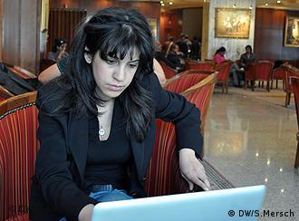 Lina Ben Mhenni at a computer