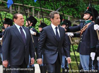 ROME, April 26, 2011 (Xinhua) -- Italian Prime Minister Silvio Berlusconi (L) and French President Nicolas Sarkozy review the honor guard before the annual Italo-French Summit at Villa Madama in Rome, Italy, on April 26, 2011. Berlusconi and Sarkozy agreed Tuesday to ask the European Union for a change in the Schengen Treaty in an effort to ease their countries' tensions over illegal immigration. (Xinhua/Wang Qingqin) (nxl) XINHUA /LANDOV