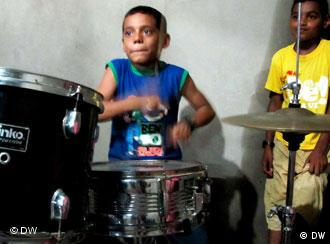 A deaf and mute child practices drums