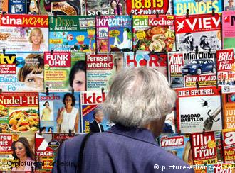 Person standing in front of magazine stand