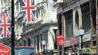 Union Jack flags hang on a street in London ready for the Royal Wedding