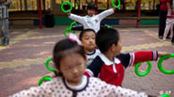Children dance during their daily afternoon exercise at a kindergarten in Beijing, China