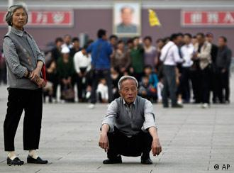 Elderly Chinese people look as they visit the Tiananmen Square in Beijing, China