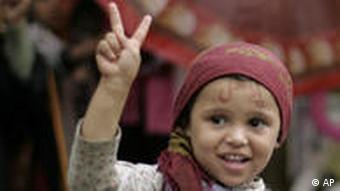 Young Yemeni girl shows a Victory sign with her fingers