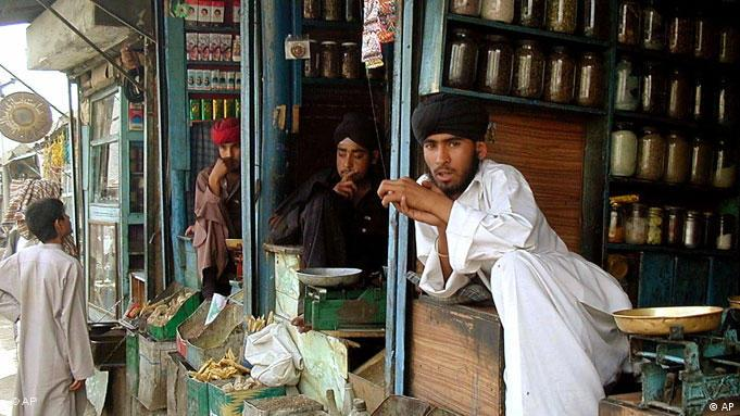 Sikhs wait for customers at their shops in downtown Kabul, Afghanistan, Wednesday, May 23, 2001. According to Taliban's Religious Police Minister Mohammed Wali, Hindus living in Afghanistan will be required to wear an identity label on their clothing to distinguish them from Muslims. The new law will only be meant for Hindus because there are no Christians or Jews in Afghanistan and Sikhs can be easily recognized by their turbans. (AP Photo/Amir Shah)