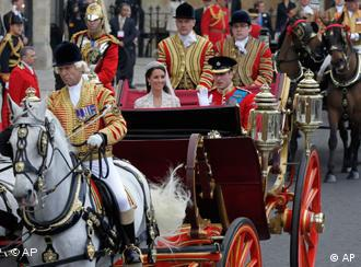 Britain's Prince William, right, and his wife Kate, Duchess of Cambridge, leave Westminster Abbey at the Royal Wedding in London Friday, April, 29, 2011. (AP Photo/Alastair Grant)