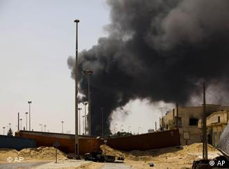 A giant column of smoke rises in the besieged city of Misrata, Libya, Friday, April 29, 2011. (AP Photo/Bernat Armangue)