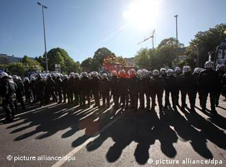 A line of policemen in Hamburg prepares to meet protesters