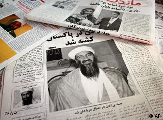 CORRECTS TO AFGHAN NEWSPAPERS - A collection of Afghan newspaper fronts show headlines referring to the killing of the al-Qaida leader Osama bin Laden, in Kabul, Afghanistan Tuesday, May 3, 2011. Bin Laden, the mastermind behind the Sept. 11, 2001, terror attacks that killed thousands of people was slain in his luxury hideout in Pakistan early Monday in a firefight with U.S. forces, ending a manhunt that spanned a frustrating decade. (AP Photo/Musadeq Sadeq)