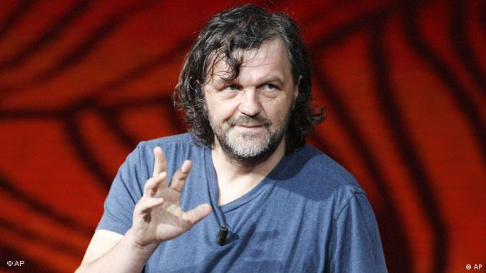 Serbian film director Emir Kusturica gestures during the Italian State RAI TV program Che Tempo che Fa, in Milan, Italy, Sunday, April 3, 2011. (AP Photo/Antonio Calanni)