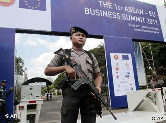 An armed police officer stands guard outside the venue of the 18th ASEAN Summit in Jakarta, Indonesia, Wednesday, May 4, 2011. Indonesia is hosting the summit that will be held on May 7-8. (AP Photo/Tatan Syuflana)