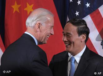 Vice President Joe Biden greets Chinese Vice Premier Wang Qishan during the opening session of the joint meeting of the U.S.-China Strategic and Economic Dialogue (S&ED), Monday, May 9, 2011, at the Interior Department in Washington. (AP Photo/Susan Walsh)