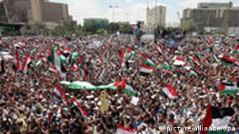 epa02730603 Egyptians hold Egyptian and Palestinian flags and shout slogans during an 'unity rally' in Tahrir Square Cairo, Egypt, 13 May 2011. According to media sources, about thousands of Egyptians gathered in central Cairo's on 13 May to take part in a Unity Rally, following clashes between Muslims and Christian that left 13 people dead earlier this week, major political groups have called on Egyptians to participate in a million-strong rally in a show of unity and solidarity, and have demanded the prosecution of those instigating religious violence. The military council blamed remnants of Mubarak's regime for inciting the unrest in a bid to cause chaos in the country. EPA/KHALED ELFIQI