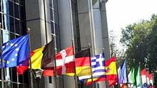 Flags of the 15 EU nations fly in front of the European Parliament in Brussels, Wednesday, Oct. 9, 2002. The European Union headquarters will recommend Wednesday, in a report presented at the Parliament, that 10 eastern neighbors be invited to join the continental body in 2004 in its most ambitious expansion ever. (AP Photo/Virginia Mayo)