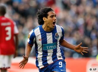 Porto's Radamel Falcao reacts after scoring the first goal during the UEFA Europa League final between Portugal's FC Porto and SC Braga at the Dublin Arena in Dublin, Ireland Wednesday May 18 2011. (AP Photo/Armando Franca)