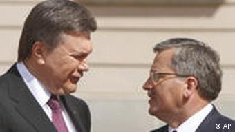 Polish President Bronislaw Komorowski, right, welcomes his counterpart Viktor Yanukovich from Ukraine to a summit of central and eastern European leaders in Warsaw, Poland, Friday, May 27, 2011. US President Barack Obama is to join the leaders for a dinner in the evening. (AP Photo/Czarek Sokolowski)