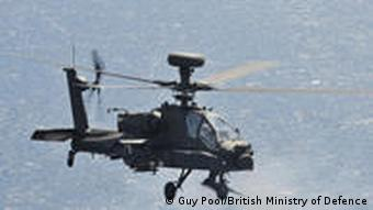 British Army Apache helicopter fires its 30mm cannon