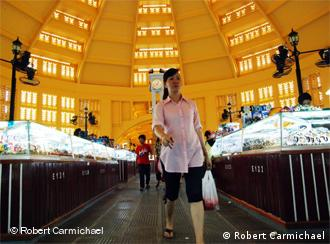 Shoppers walk through the jewellery section under the Central Market's 45-metre diameter dome