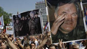 Bosnian Serb's hold photos of former Bosnian Serb general Ratko Mladic, right, and former Bosnian Serb leader Radovan Karadzic with Mladic, center, during a protest in support of Gen. Ratko Mladic, in Banja Luka 240 kms northwest from Sarajevo, Bosnia, on Tuesday, May 31, 2011. Thousands of supporters are protesting the arrest of Ratko Mladic, the former Bosnian Serb military commander charged with genocide by a U.N. court.(AP Photo/Amel Emric)