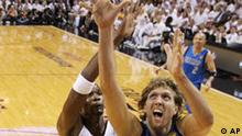 Dallas Mavericks' Dirk Nowitzki (41) shoots past Miami Heat's Chris Bosh during the first half of Game 2 of the NBA Finals basketball game Thursday, June 2, 2011, in Miami. (AP Photo/Ronald Martinez; Pool)