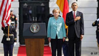 President Barack Obama welcomes German Chancellor Angela Merkel on the South Lawn of the White House in Washington, Tuesday, June 7, 2011. (AP Photo/Charles Dharapak)