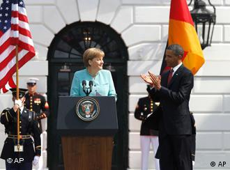President Barack Obama applauds after German Chancellor Angela Merkel spoke on the South Lawn at the White House in Washington, Tuesday, June 7, 2011. (AP Photo/Charles Dharapak)