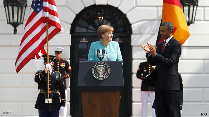 US President Barack Obama bestows German chancellor Angela Merkel the Presidential Medal of Freedom in front of the White House. (Photo: AP Photo/Charles Dharapak)