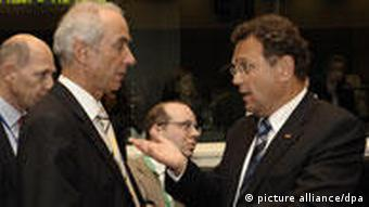German interior minister Hans-Peter Friedrich with Dutch immigration minister Gerd Leers