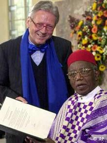 Nigerian author Chinua Achebe, right, receives the German Booksellers Peace Prize from the President of the German book trade association, Dieter Schormann, Sunday, Oct. 13, 2002, in the Paulschurch in Frankfurt, Germany
