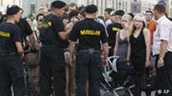 Belarusian policemen block a central street to protect it from a youth opposition action Revolution via social network in Minsk, Belarus, Wednesday, June 15, 2011