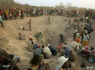 miners dig for diamonds in Marange in 2006