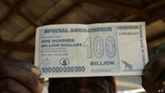 A man holds a 100 billion dollar note in Zimbabwe (AP)