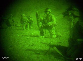 Images of US soldiers performing operations by night