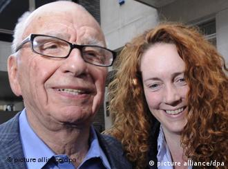 epa02828323 (FILES) A file photo dated 10 July 2011 showing Rebekah Brooks, then chief executive of News International (R) walking into a hotel with Rupert Murdoch (L) Chairman of News Corporation in London . According to news reports on 17 July 2011, Brooks has been arrested by Metropolitan Police as part of phone hack investigation. EPA/FACUNDO ARRIZABALAGA