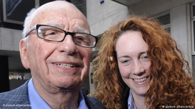 A file photo dated 10 July 2011 showing Rebekah Brooks, then chief executive of News International (R) walking into a hotel with Rupert Murdoch (L) Chairman of News Corporation in London .