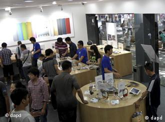 Customers browse products at a shop masquerading as a bona fide Apple store