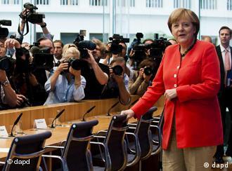 Chancellor Angela Merkel with journalists