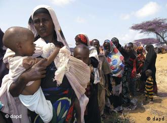 Women and children in Somalia line up for food