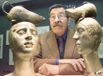 Guenter Grass posing with his sculptures