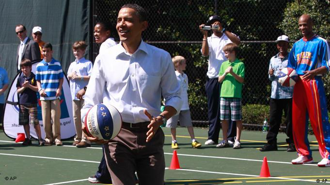 President Barack Obama attends a basketball workshop with children as part of the Let's Move campaign, Monday, April 25, 2011, at the White House Easter Egg Roll on the South Lawn of the White House in Washington. (AP Photo/Charles Dharapak)