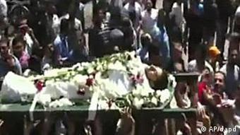 مراسم تشییع قربانیان در شهر حماه