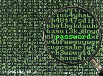 Screen full of alphanumerics depicting encryption and the word password emphasized by a magnifying glass password; encryption; hacking; security; protect; safe; access; hacker; technology; information; magnify; magnifying; secure; computer; laptop; screen; identity; theft; crime; cyber; secret; electronic; encrypt; confidential; digital; network; internet; cyberspace