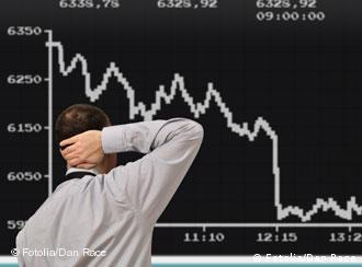 trader in front of Dax screen