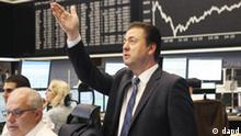 Robert Halver, chief analyst of a German private bank gestures at the stock market in Frankfurt, Germany, Tuesday, Aug.9, 2011, where the stock index DAX went up in the afternoon when the NYSE opened. (Foto:Michael Probst/AP/dapd)