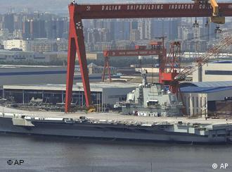 In this photo taken on Aug. 6, 2011, a Chinese aircraft carrier, which had been under refurbishment, is docked at Dalian port in in northeast Liaoning province. China's first aircraft carrier started sea trials Wednesday, Aug. 10, 2011, a step that will likely boost concerns about the country's naval ambitions amid sea territorial disputes. (Foto:Color China Photo/AP/dapd) CHINA OUT