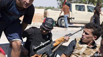 Libyan rebels seen in the back of a truck near the frontline near Zawiya
