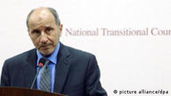 epa02865596 Chairman of the Libyan National Transitional Council (TNC) Mustafa Abdel Jalil speaks during a press conference, in Benghazi, Libya, 13 August 2011. The TNC announced 08 august it had fired its executive board and asked Chairman Mahmoud Jibril to appoint a new one as part of the continuing fallout from the assassination of rebel General Abdul Fatah Younis. According to media reports, Rebel forces and Gaddafi soldiers are fighting at Gharyan a strategic city located about 50 kilometers from Tripoli. Reports also say that Libyan families try to flee the Libyan capital, as rebel pushing forward to Tripoli. EPA/STR +++(c) dpa - Bildfunk+++